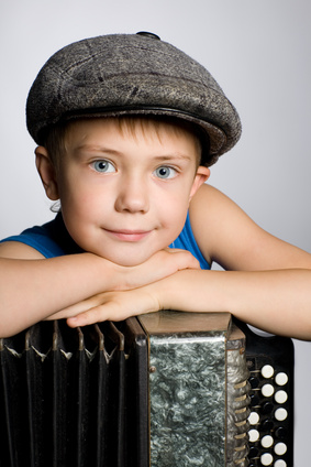 Smiling boy with accordion